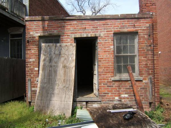 run down old brick house